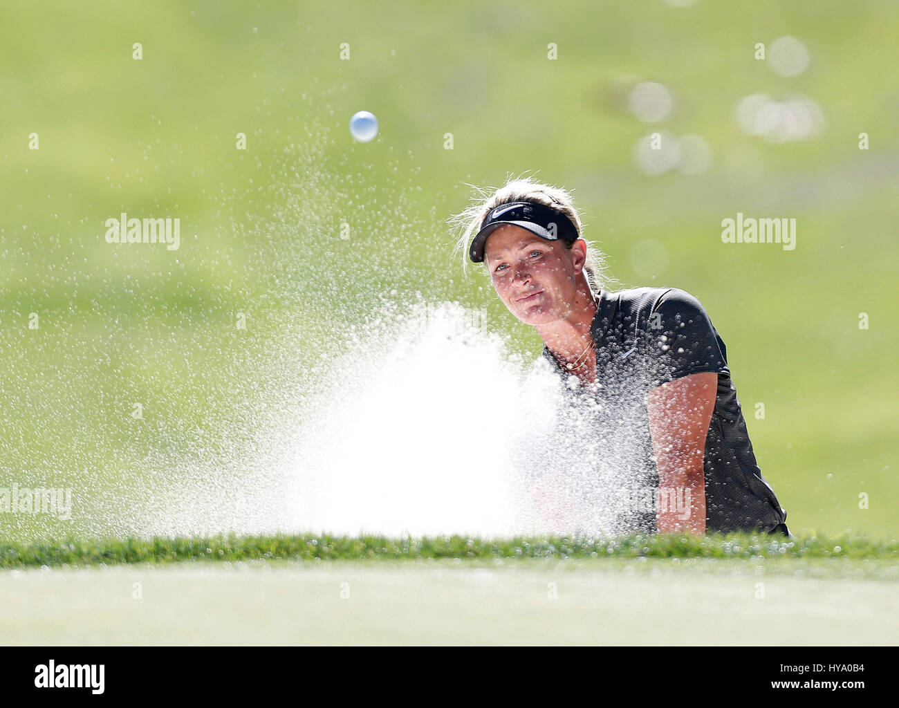 April 02, 2017 Suzann Petterson of Norway hits out of a bunker on the eighth hole during the final round of the Stock Photo