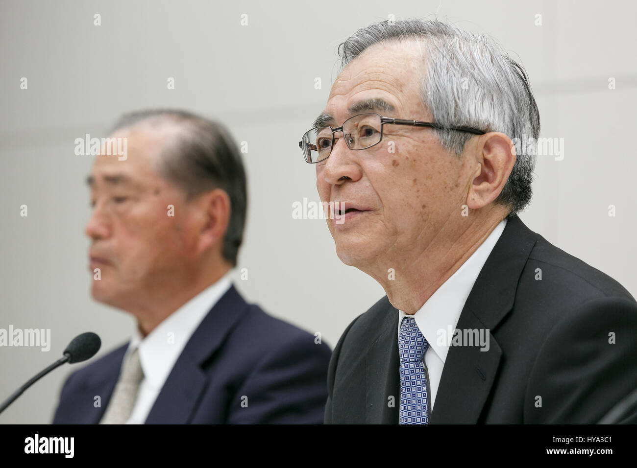 (L to R) Tokyo Electric Power Co (TEPCO) Holdings current chairman Fumio Sudo and new chairman Takashi Kawamura, - Stock Image