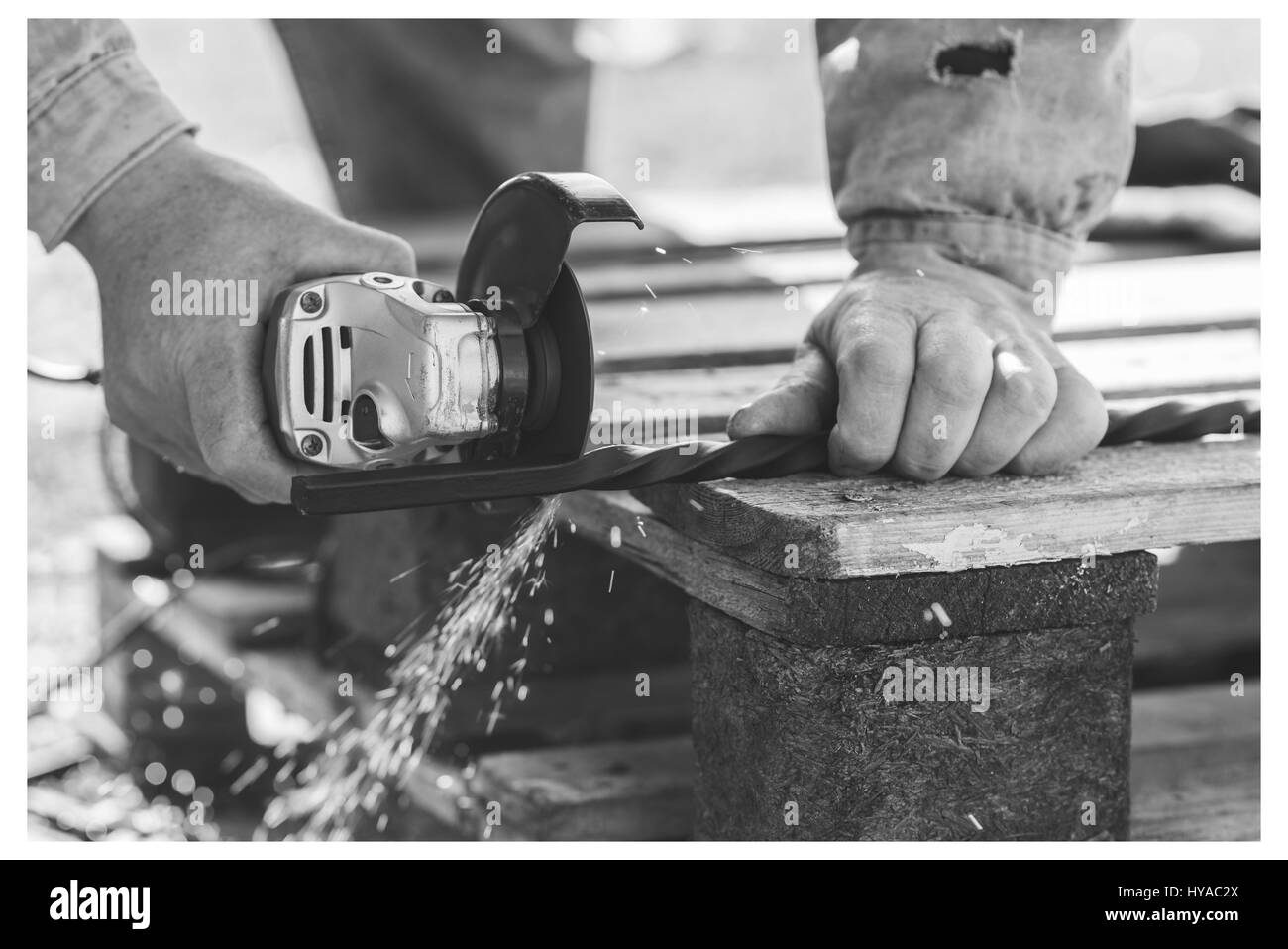 The process of cutting metal using the angle grinder. Ukraine - Stock Image