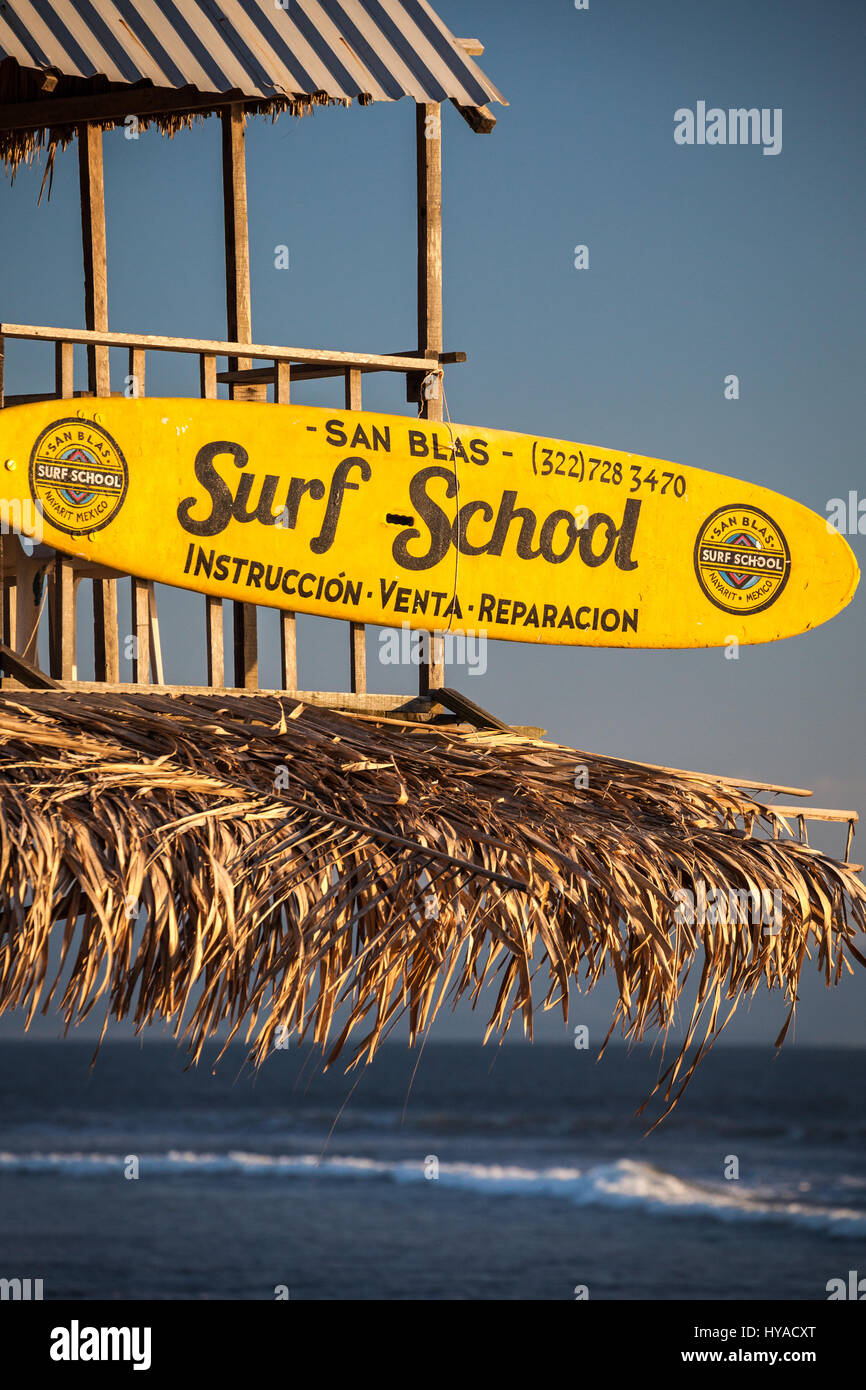 Surf school sign on the beach of San Blas, Nayarit, Mexico. - Stock Image