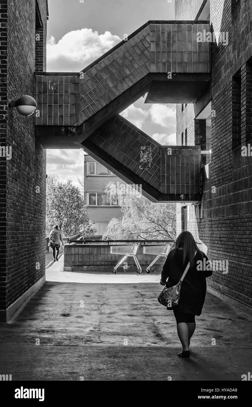 Walking down an alleyway past King Edward Court  car park in Windsor, UK. - Stock Image