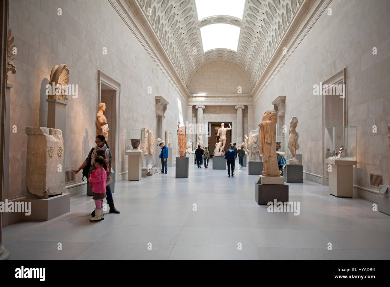Greek and Roman statues and carvings occupy a long corridor at the Metropolitan Museum of Art in Manhattan. Feb. Stock Photo
