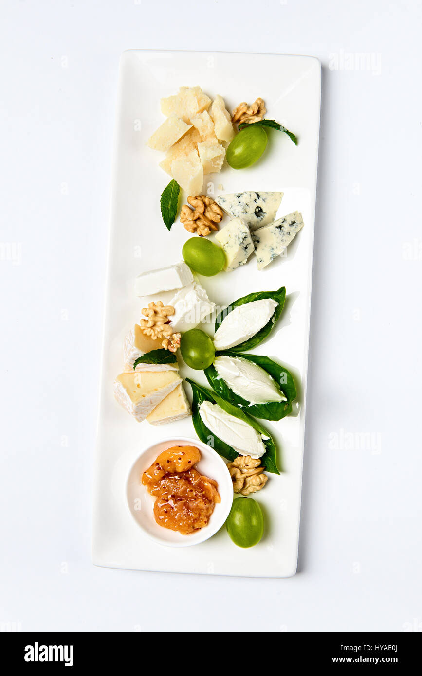 Various cheese type dish served luxery, isolated - Stock Image