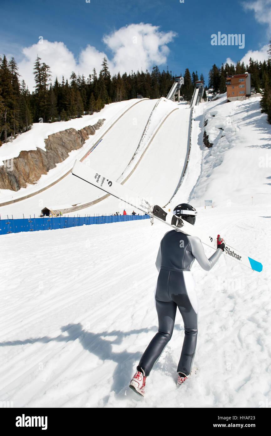 A jumper walks past the ski jumps 2017 CDN National Championships.    Photo:  David Buzzard - Stock Image
