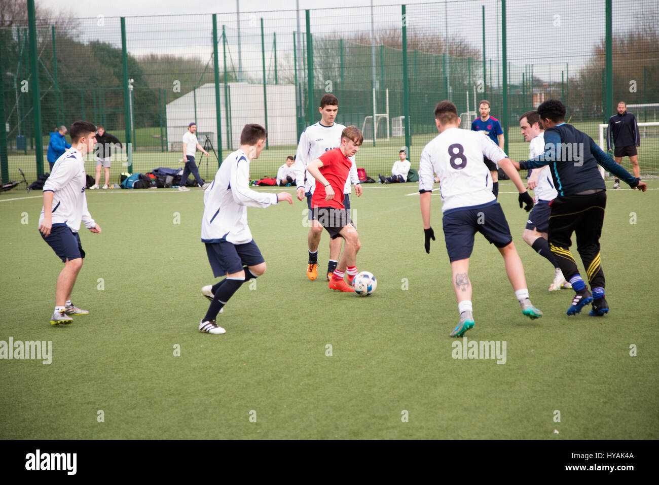 Teenagers playing 5 A Side football in Dublin city, Ireland. Stock Photo