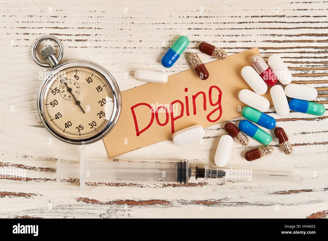 Stopwatch, syringe and pills. - Stock Image