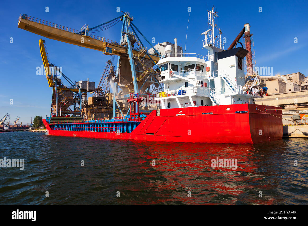 Loading phosphate fertilizers in the port of Gdansk, Poland. - Stock Image