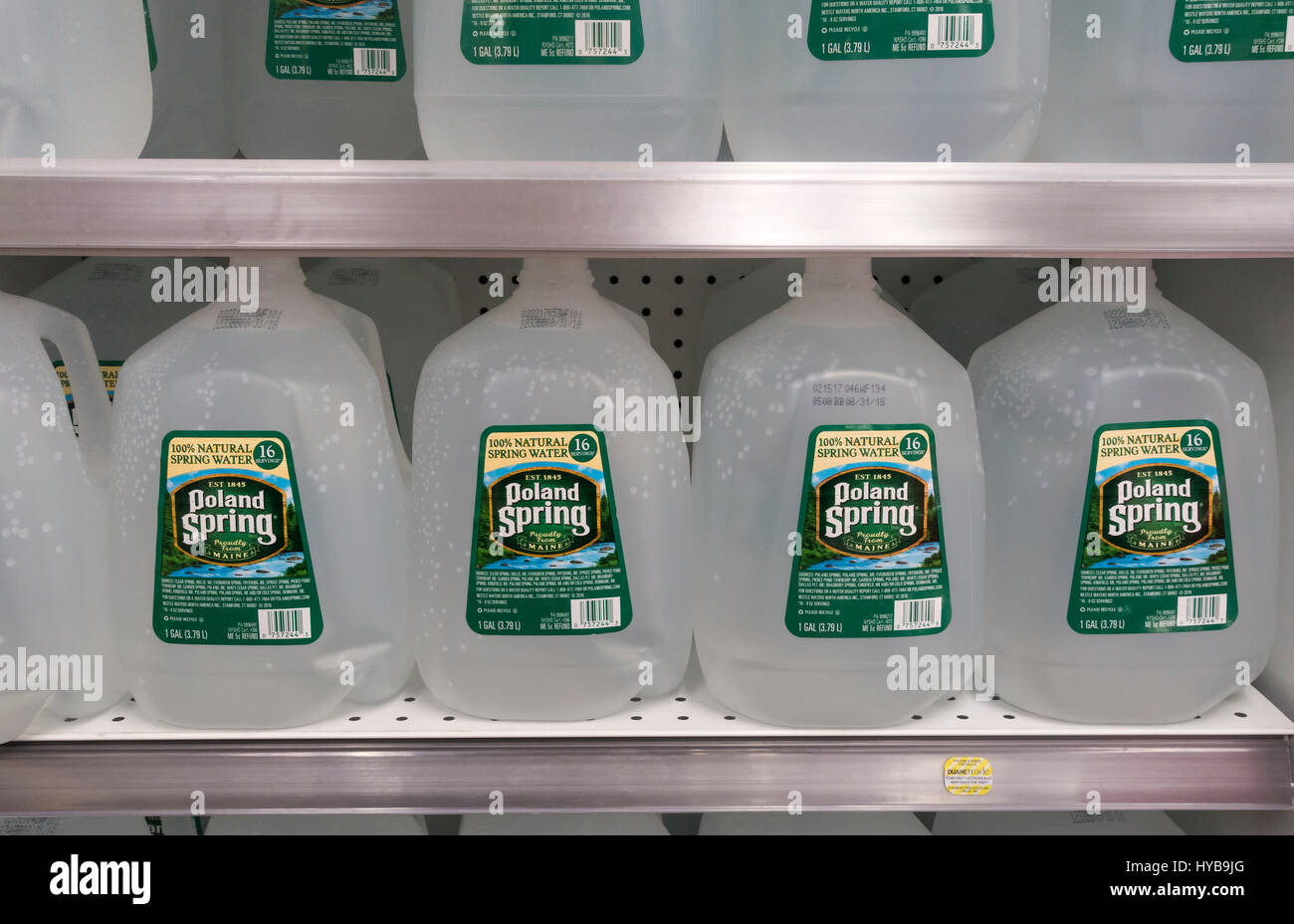 Plastic one gallon bottles of Poland Spring water Stock