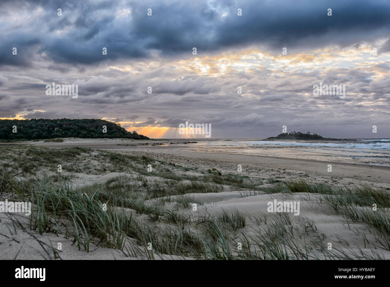 Atmospheric sky at sunrise over Conjola Beach, Shoalhaven, South Coast, New South Wales, NSW, Australia - Stock Image