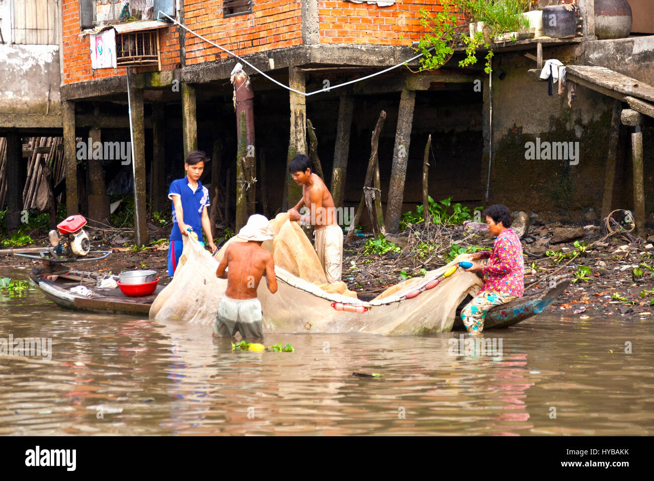 Hauling in the fish catch is a family business - Stock Image