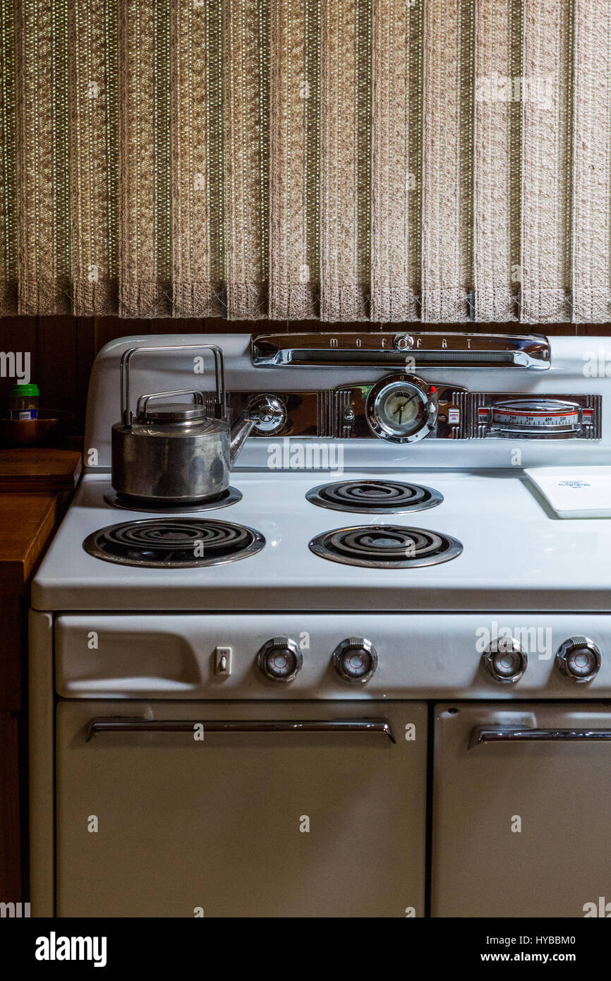 Old stove with a tee pot Stock Photo