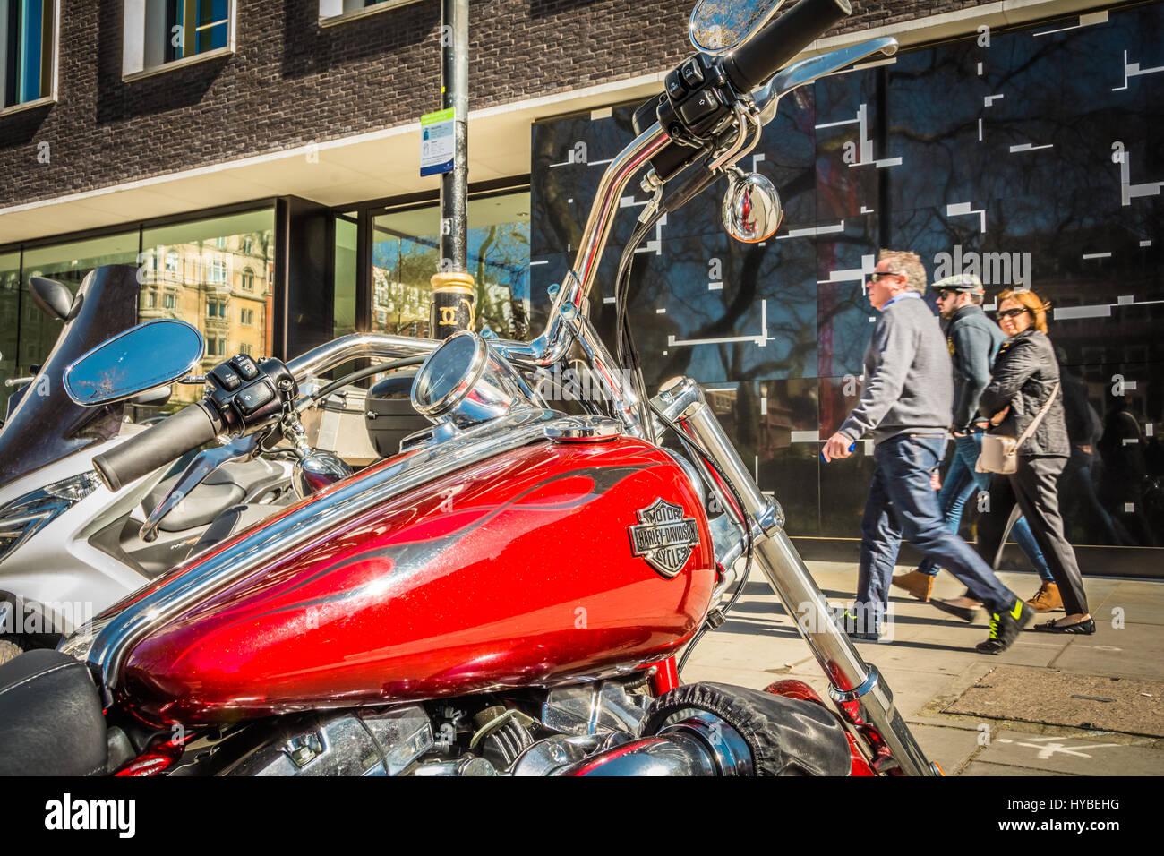 A red Harley Davidson motorbike in Hanover Square, London, UK - Stock Image