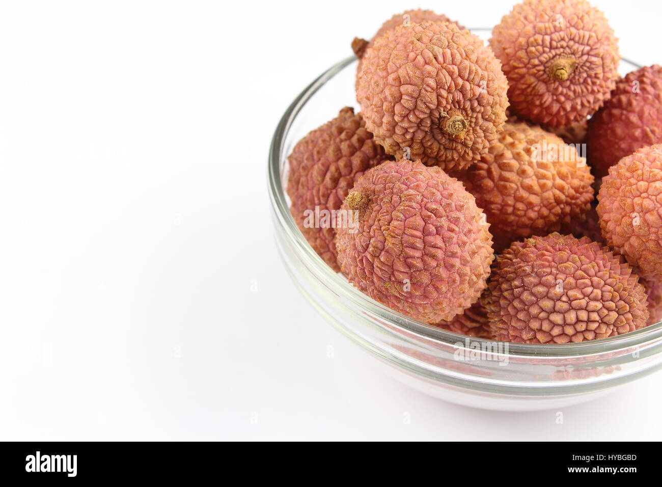 composition of lychee fruits in a small glass bowl - Stock Image