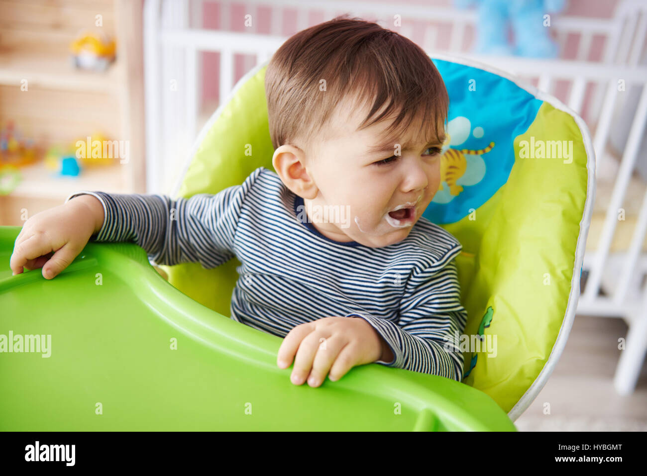 Crying baby boy over feeding time - Stock Image