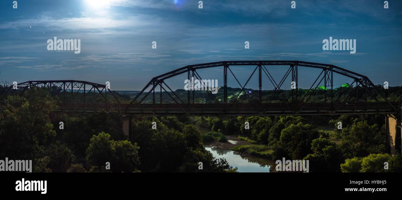Bridge under the moon Stock Photo