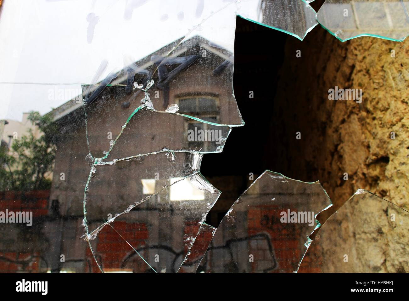 A broken window of an abandoned building near Brito Capelo street in Matosinhos, Porto, Portugal. - Stock Image