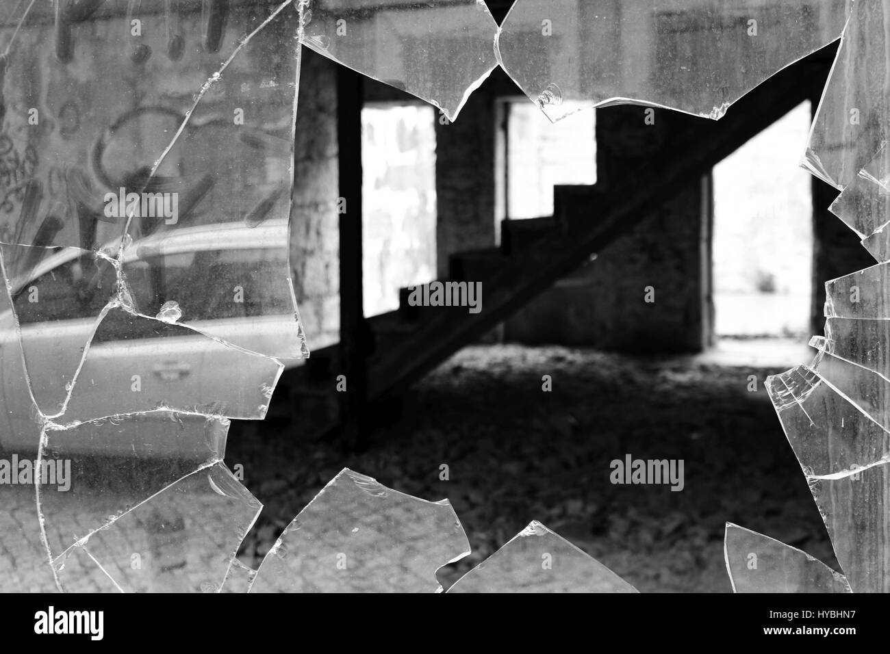 A black and white shot of a broken window of an abandoned house in the centre of Matosinhos, Porto, Portugal. - Stock Image