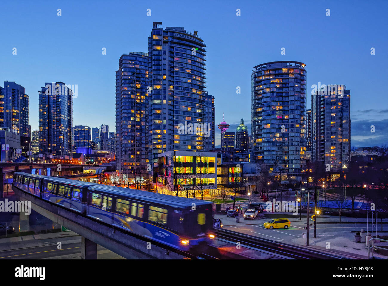 Skytrain rapid transit elevated rail, night time, downtown Vancouver, British Columbia, Canada. - Stock Image