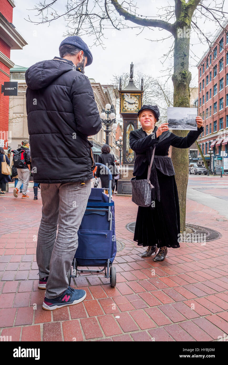 Tour guide in period costume, Gastown, Vancouver, British Columbia, Canada. - Stock Image