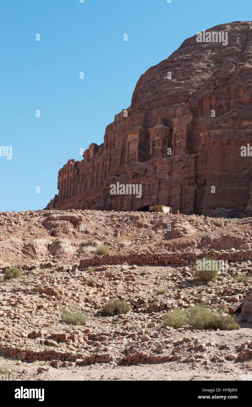 Jordan: the Kings Wall with the Royal Tombs, huge funerary structures carved into the rock face in the archaeological Stock Photo