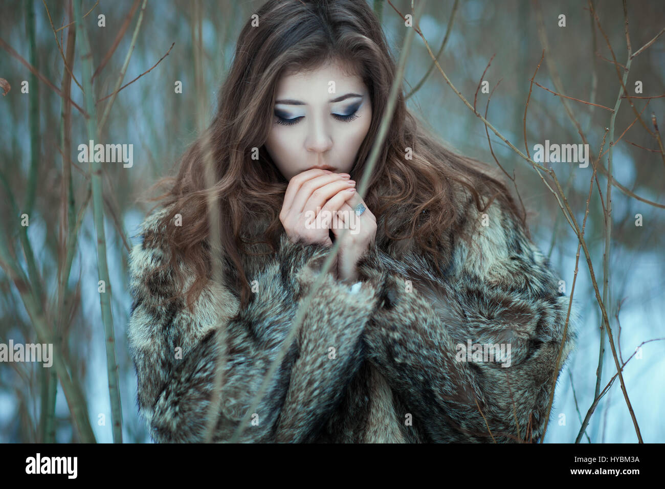 Girl breathes in the cold hands. Closeup portrait sweet girl. - Stock Image