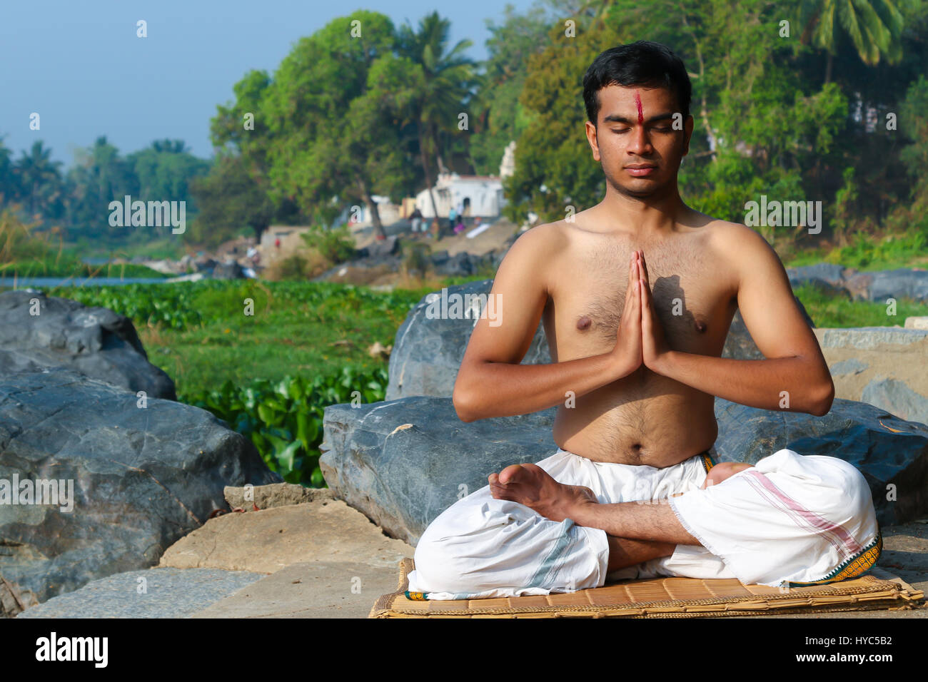 Indian Man Practicing Yoga Meditation Next To A River In South Stock Photo Alamy