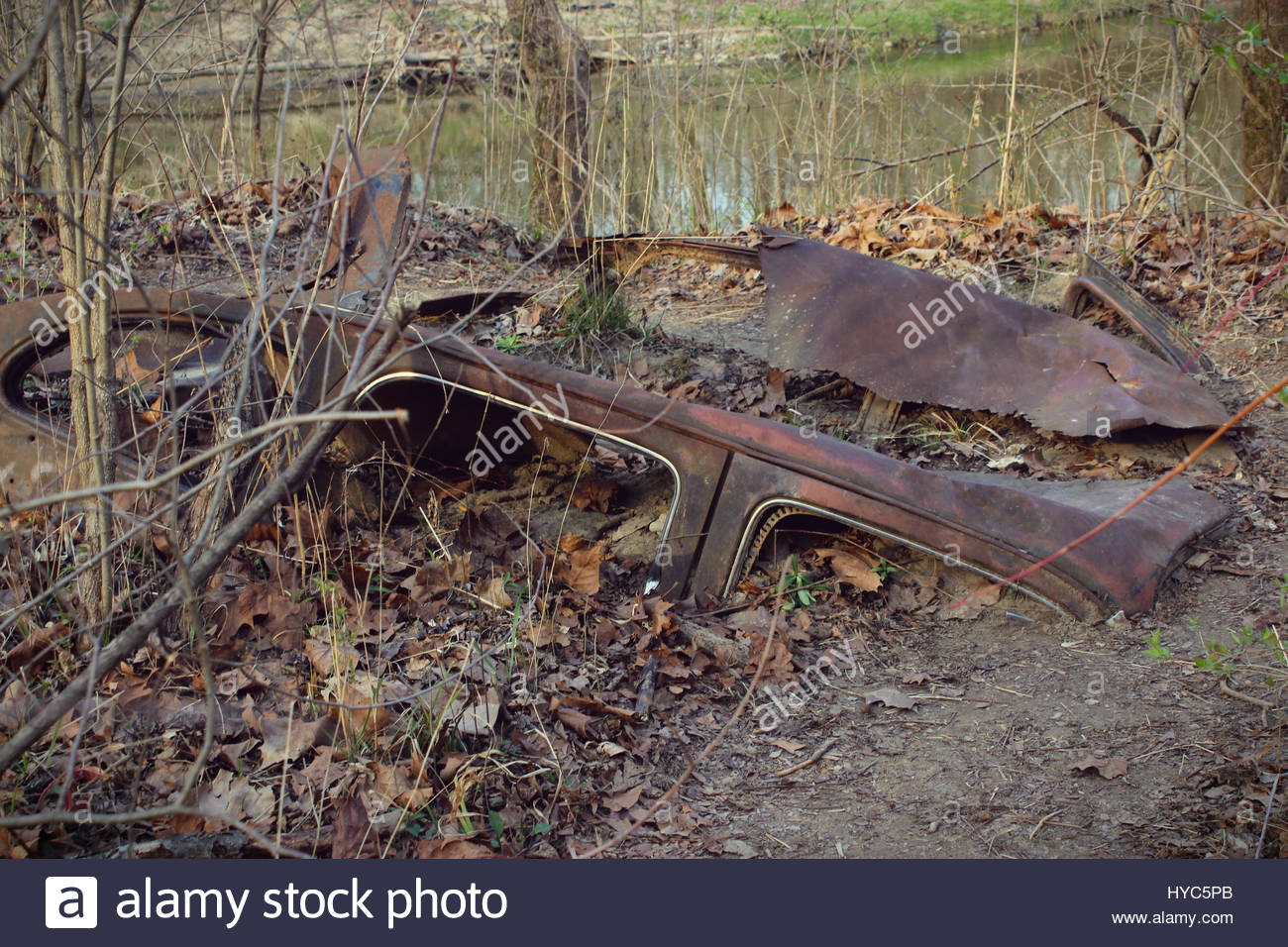 Old abandoned car in local park - Stock Image