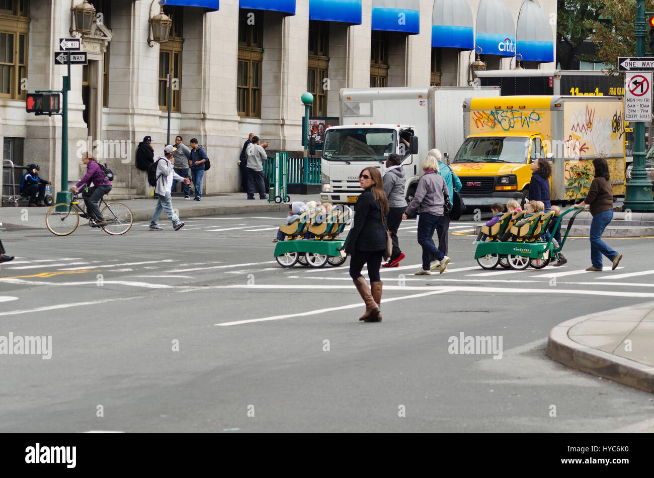 road crossing with children garden multi seater pram, new york, usa - Stock Image