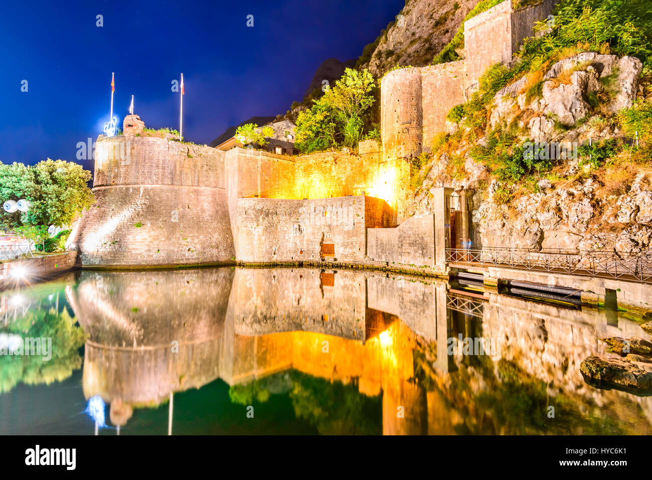 Bay of Kotor, Montenegro. Venetian fortress of Kotor and Scurda river. Tower and wall, mountain Lovcen at the background. Stock Photo