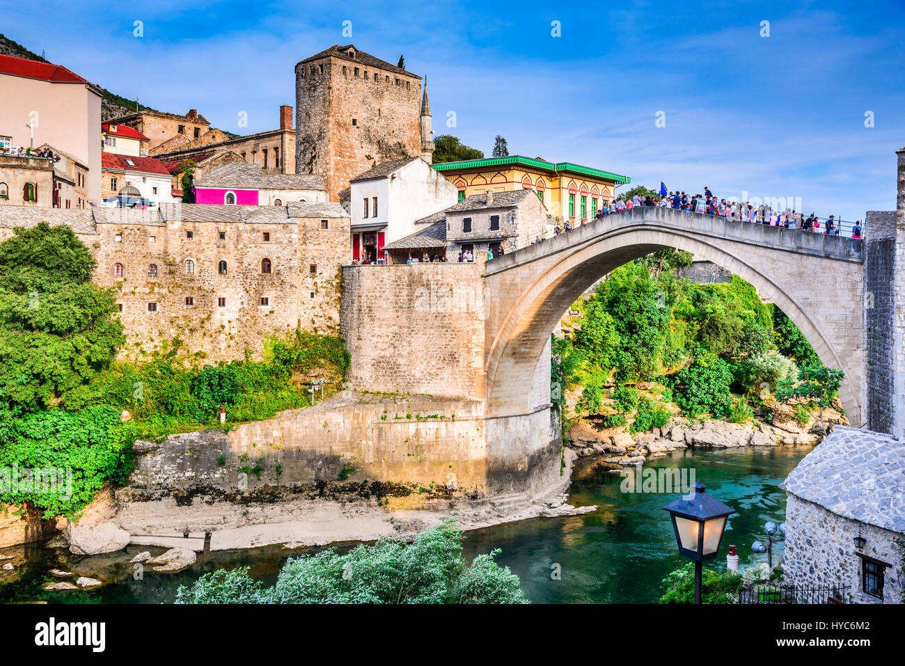Mostar, Bosnia and Herzegovina. Morning sun on Nerteva River and Old City of Mostar, with Ottoman Mosque - Stock Image