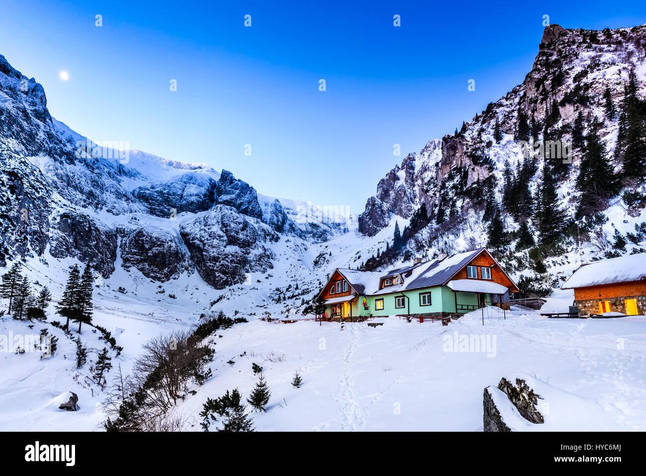 Carpathian Mountains, Romania. Winter twilight in Bucegi Mountains Natural Park, Malaiesti valley and touristic - Stock Image
