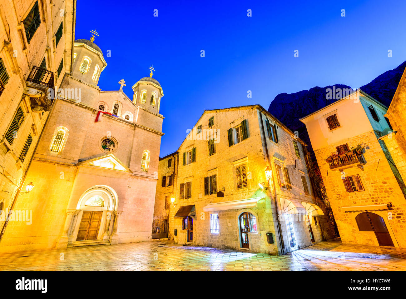 Kotor, Montenegro - Orthodox cathedral in night, with Lovcen mountains in background. Stock Photo