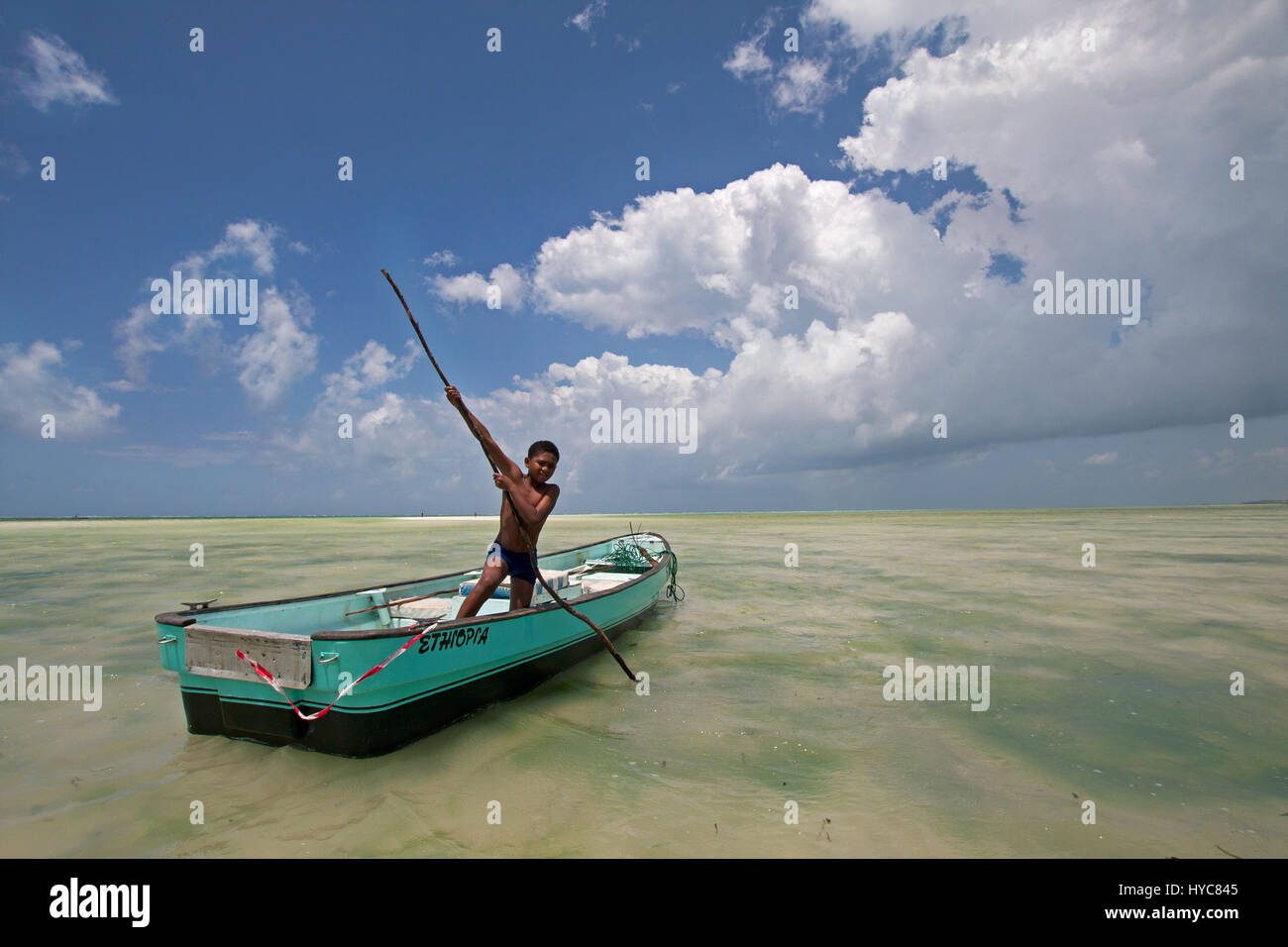 child rowing a boat, watamu, kenya, africa - Stock Image