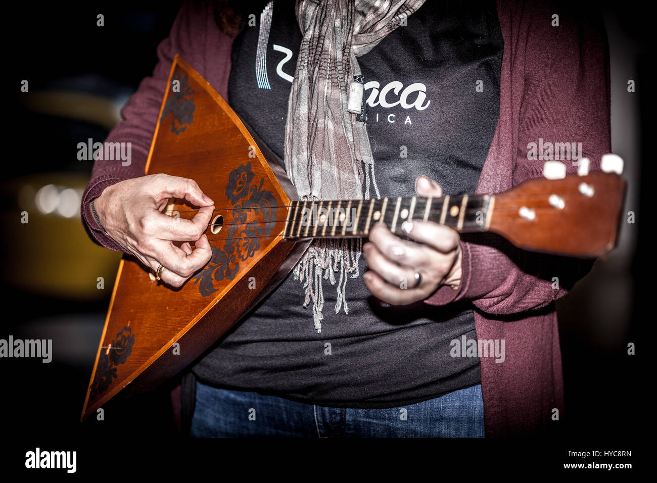 woman playing the balalaika - Stock Image