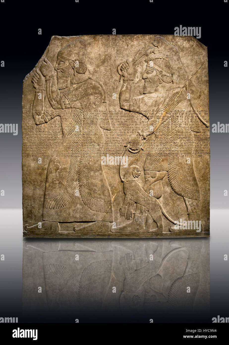 Assyrian relief sculpture panel  of Tribute bearers, the first one has a turban from north-west Syria and raises Stock Photo