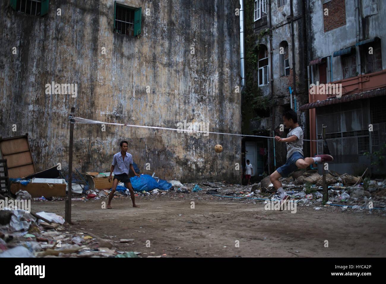 boys playing soccer, yangon, myanmar, burma - Stock Image