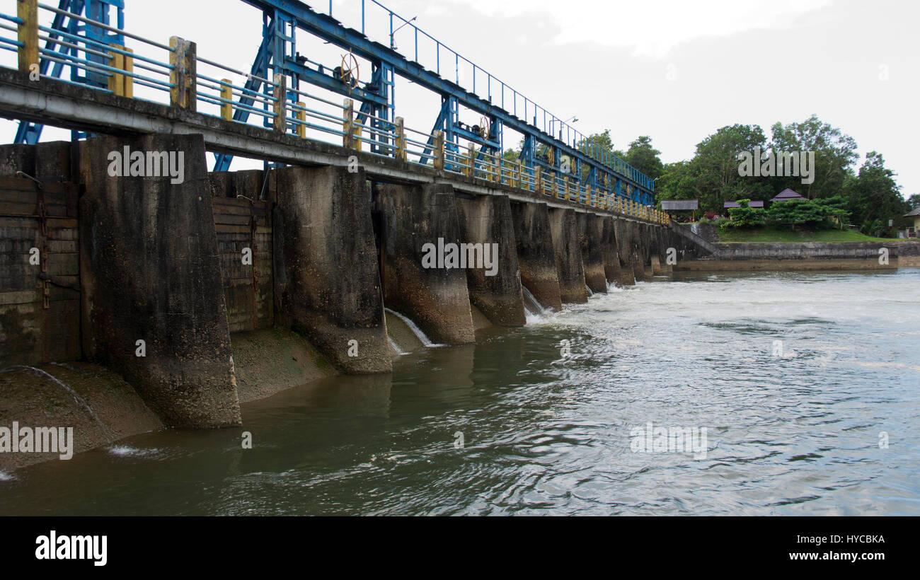 Small blue dam and bridge crossing the river in asia Stock Photo