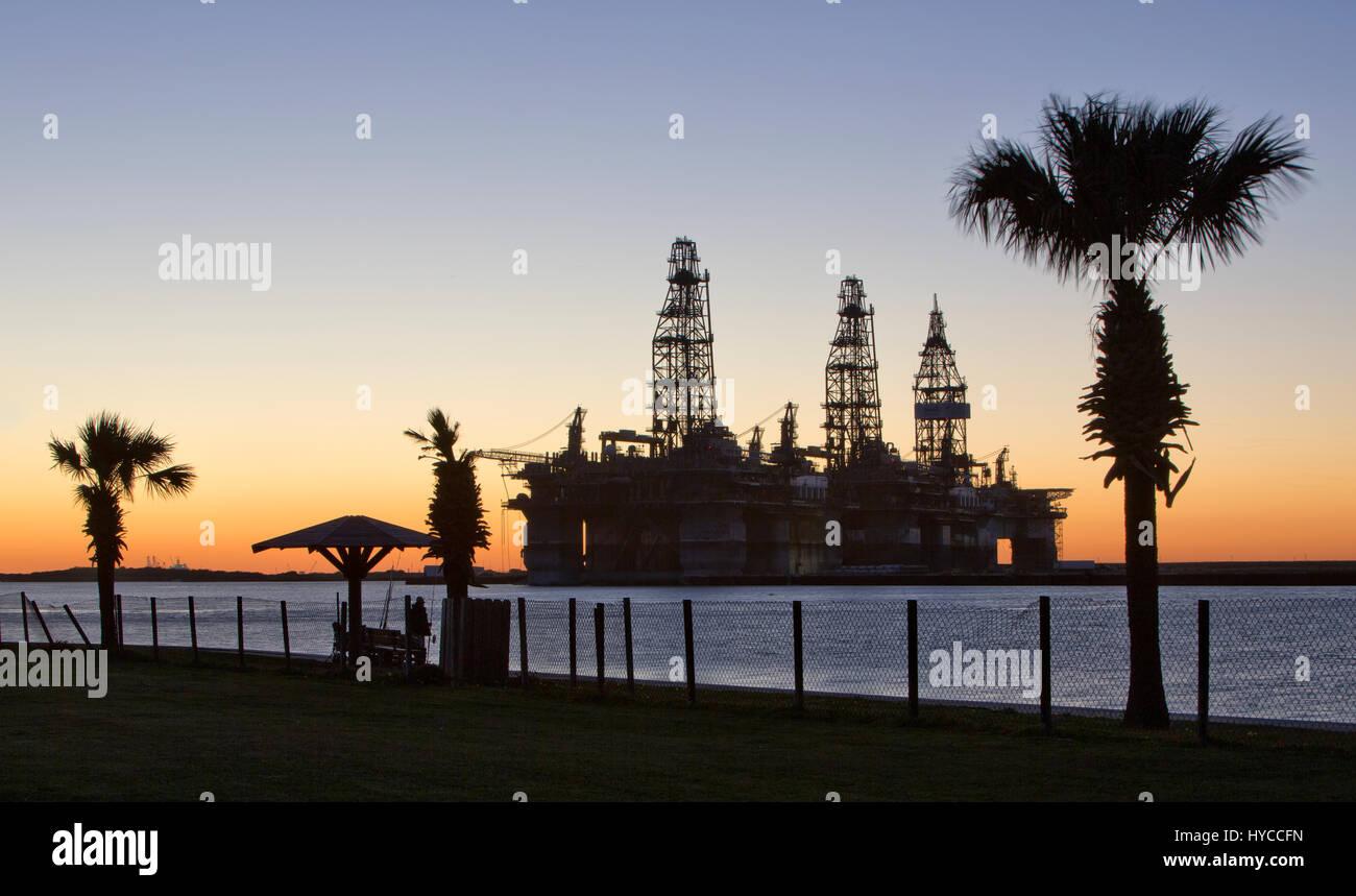 Deep water drill rigs temporarily in storage,  sunset,  Harbor Island,  Canyon Port, Texas Gulf Coast,  Port Aransas. Stock Photo