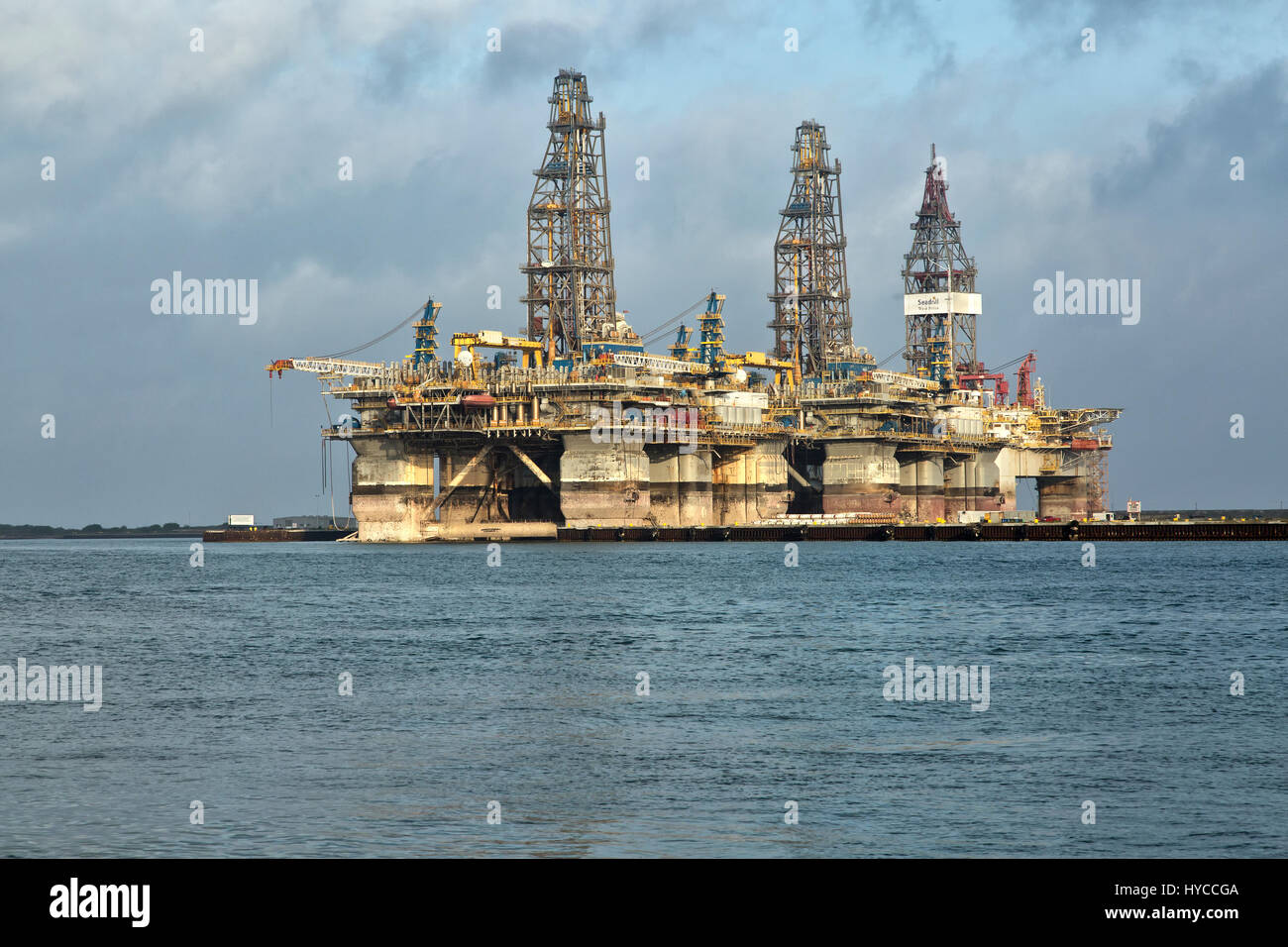 Deep water drill rigs temporarily in storage,  pm light, Harbor Island,  Canyon Port, Port Aransas. Stock Photo