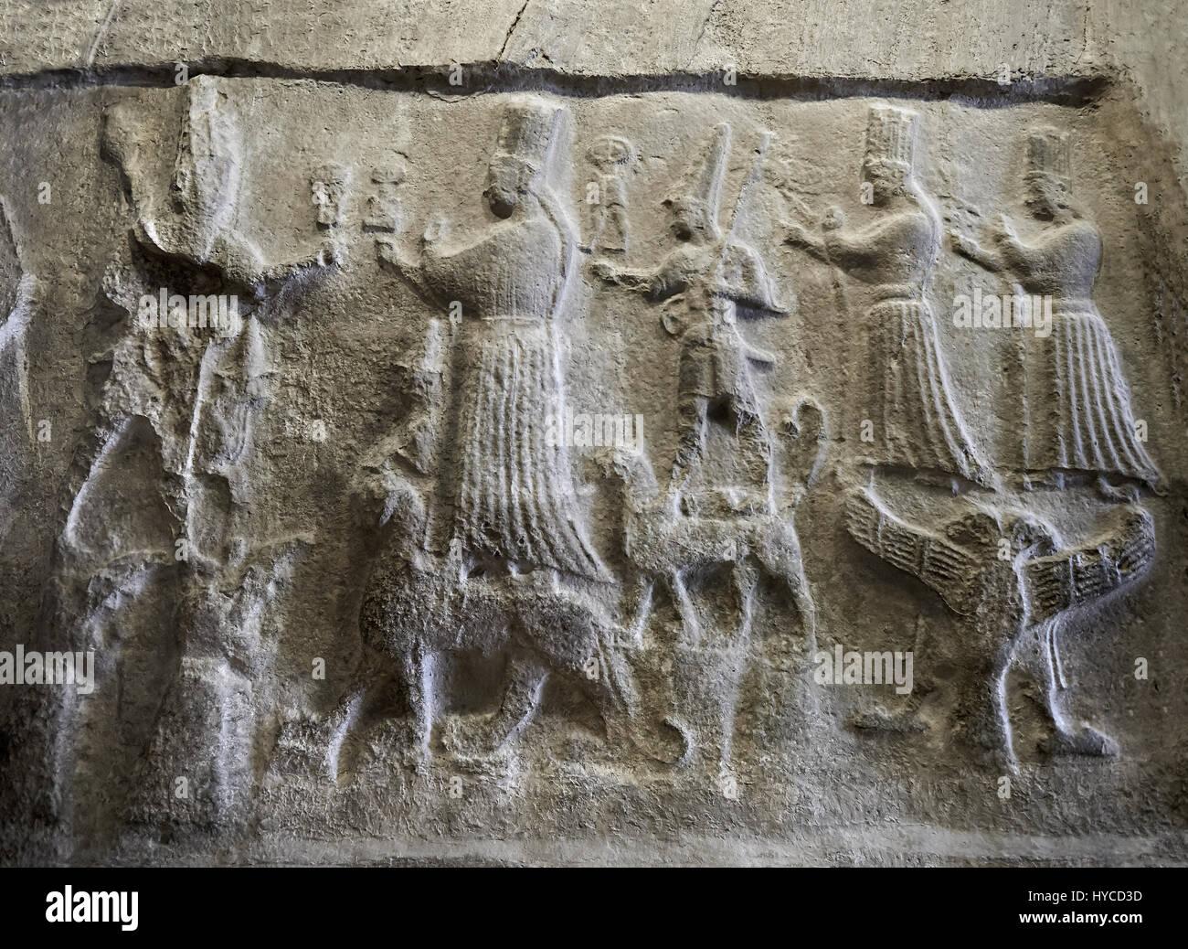 Hittite relief sculptures of Gods at the Yazilikaya Sancutary [ i.e written riock ], Hattusa, Turkey.  The largest - Stock Image