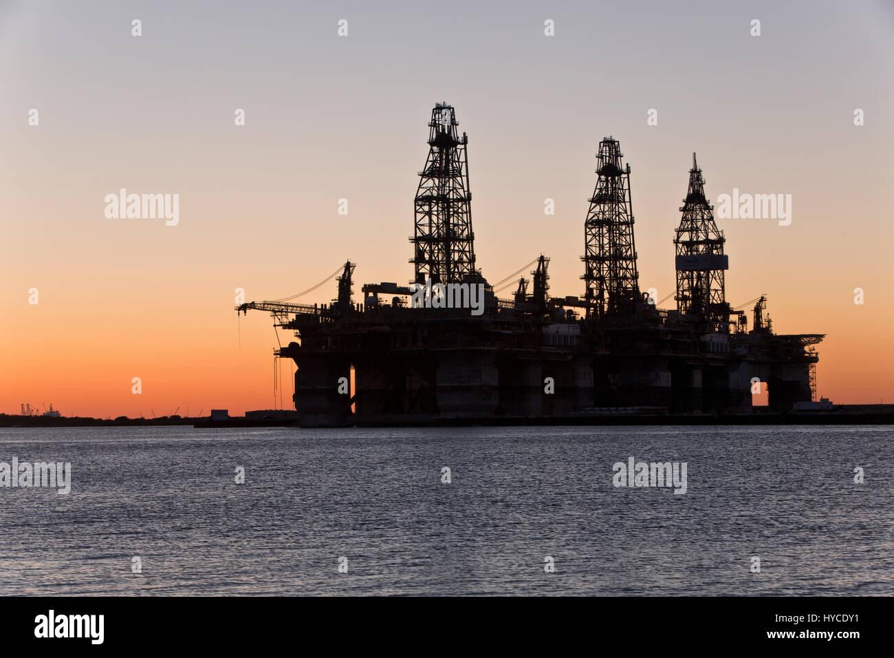 Deep water drill rigs temporarily in storage,  sunset, Harbor Island,  Canyon Port, Port Arius petroleum Aransas. Stock Photo