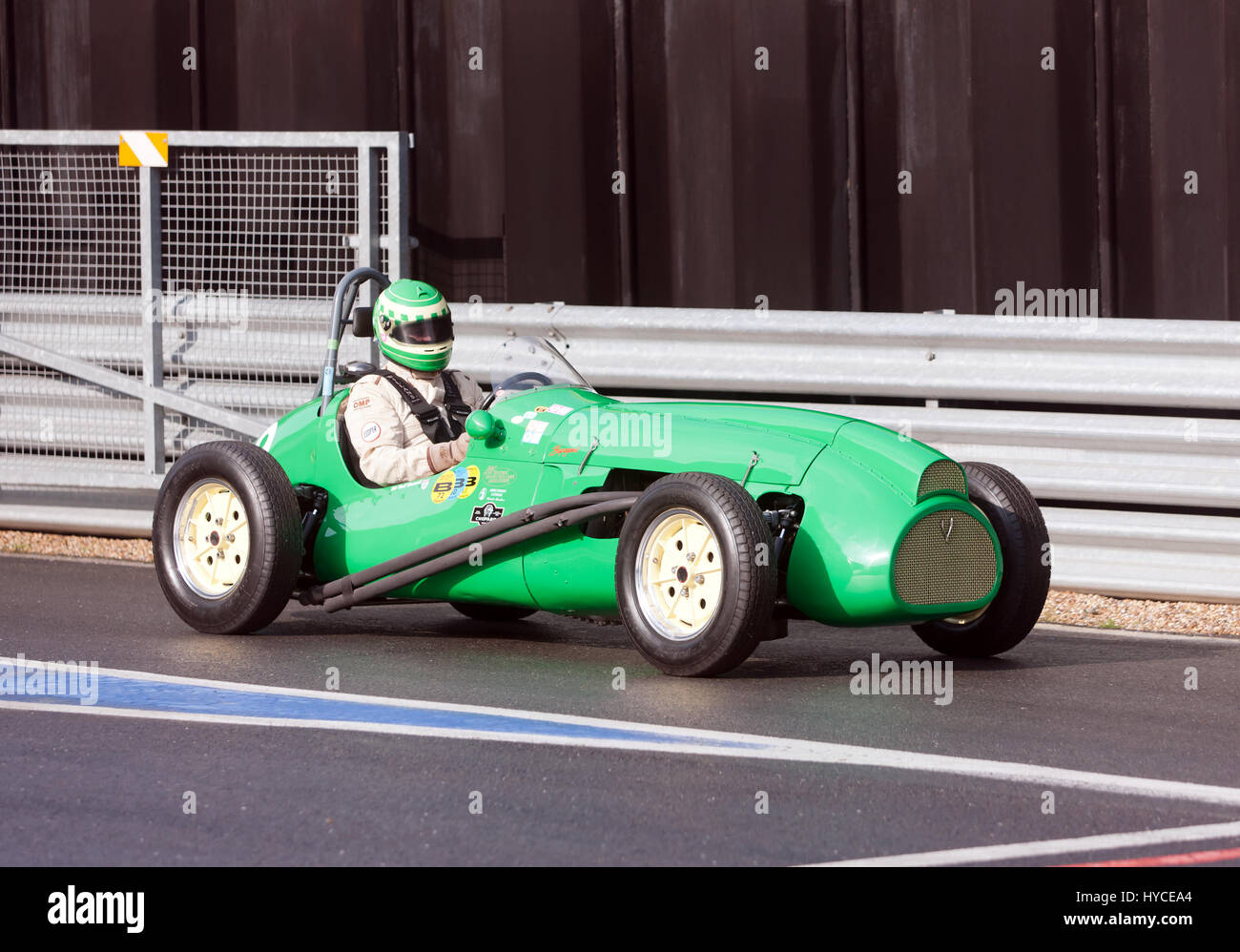 A Cooper T23 Bristol Racing car, formerly owned by Bob Gerrard,   exiting the International Pit Lane, during the - Stock Image
