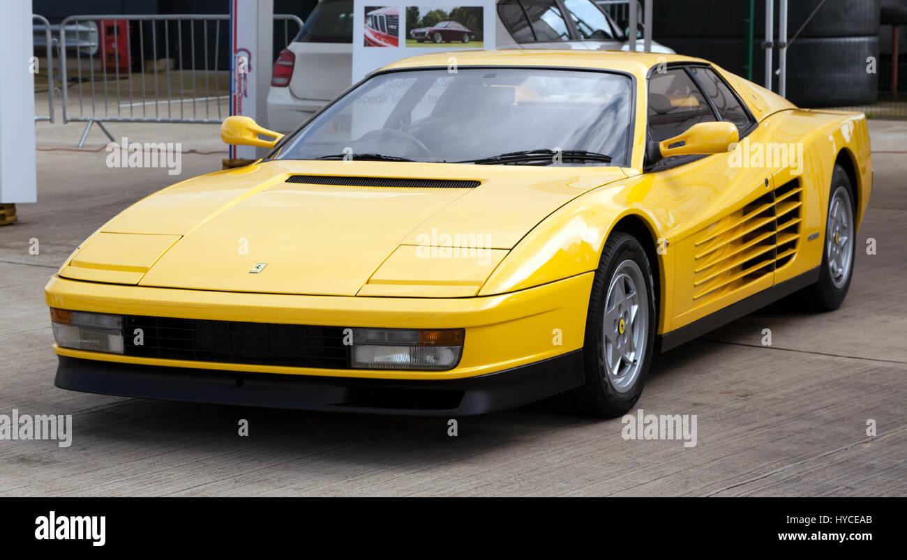 Three-quarter view of a yellow Ferrari Testarossa, on display at the