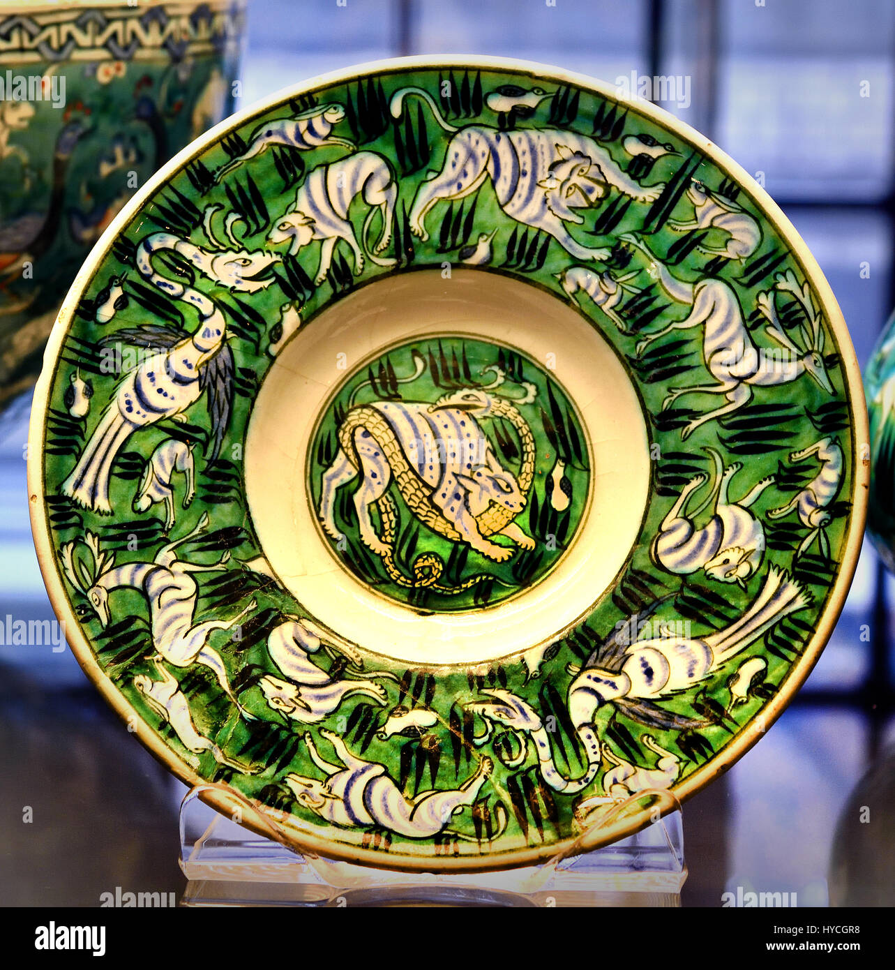 Dish decorated with real and fantastic creatures including a Simurgh ( Iranian mythical bird ) Iznik Ottoman dynasty - Stock Image