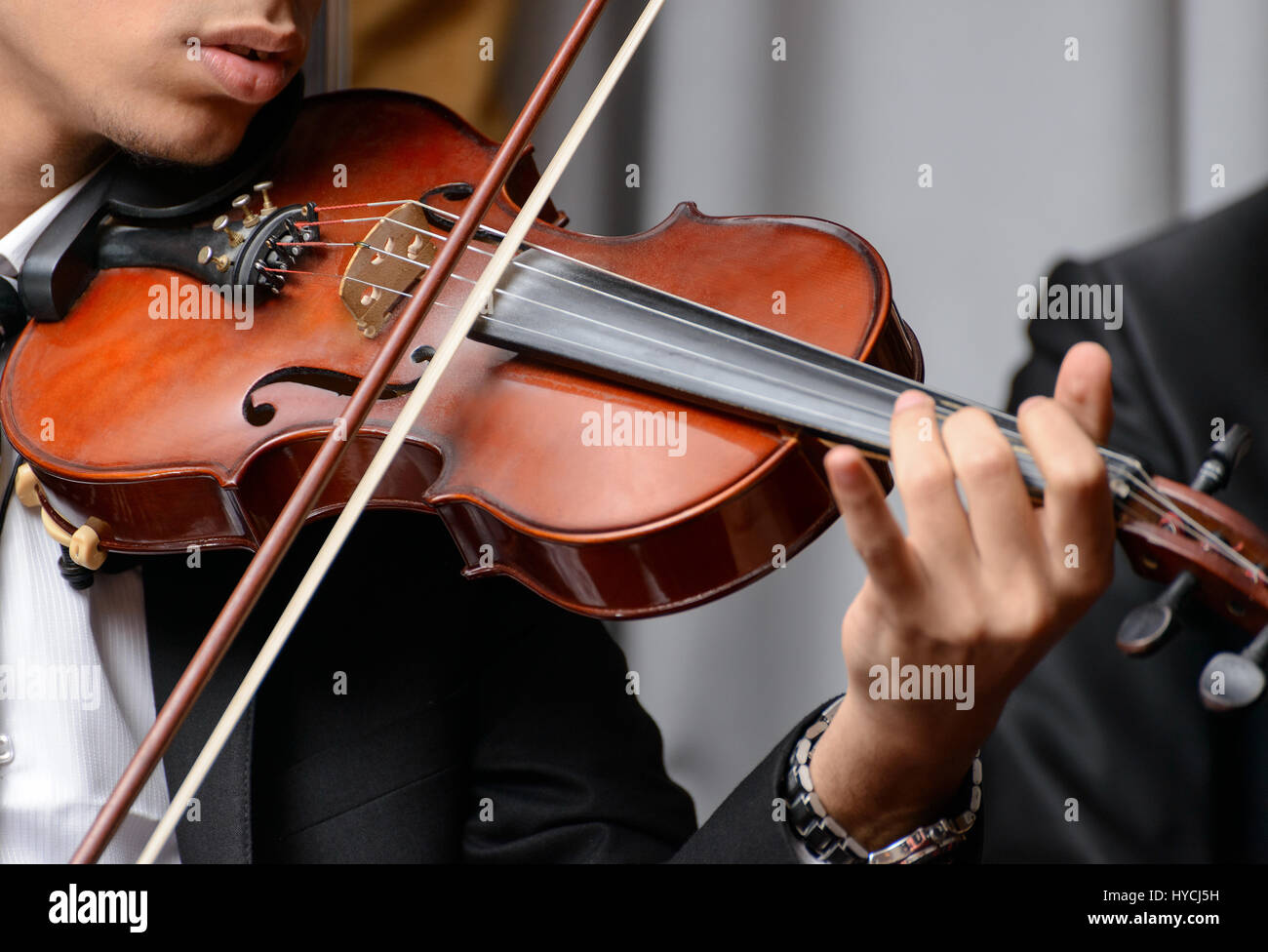 Violinist Playing a Note During a Symphony - Stock Image