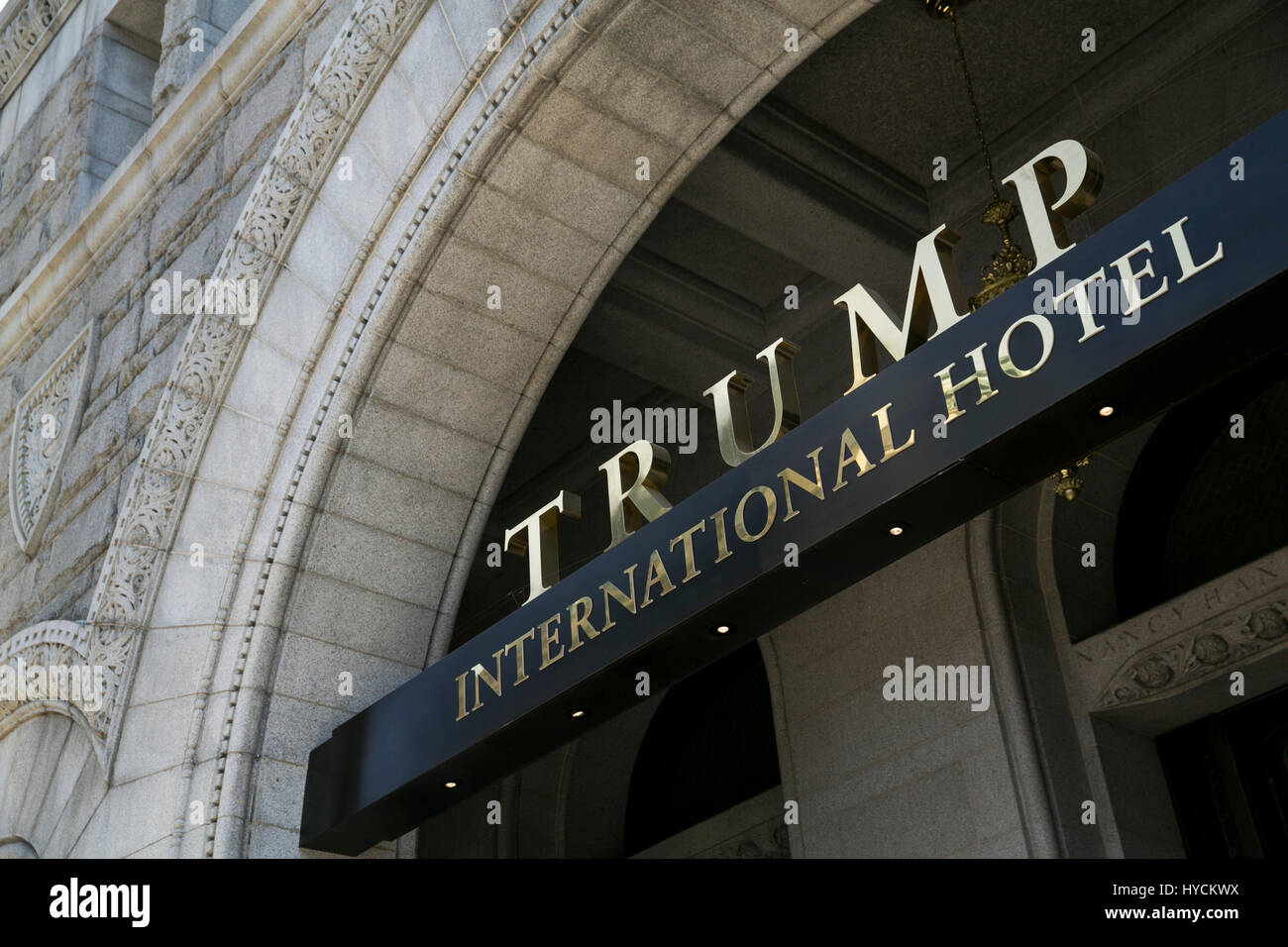 A logo sign outside of the Trump International Hotel in the Old Post Office building in downtown Washington, D.C., - Stock Image
