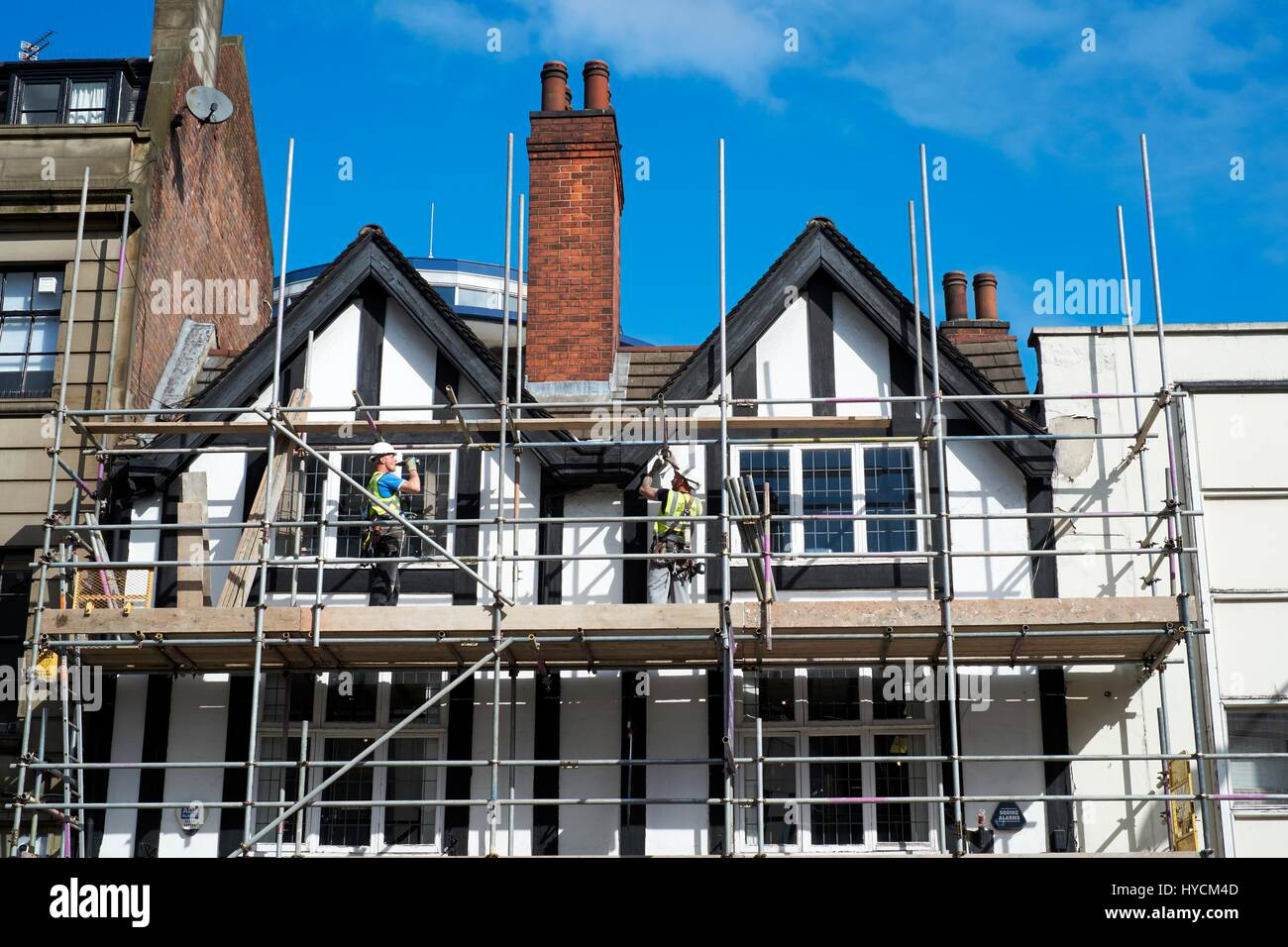 Working on scaffolding - Stock Image