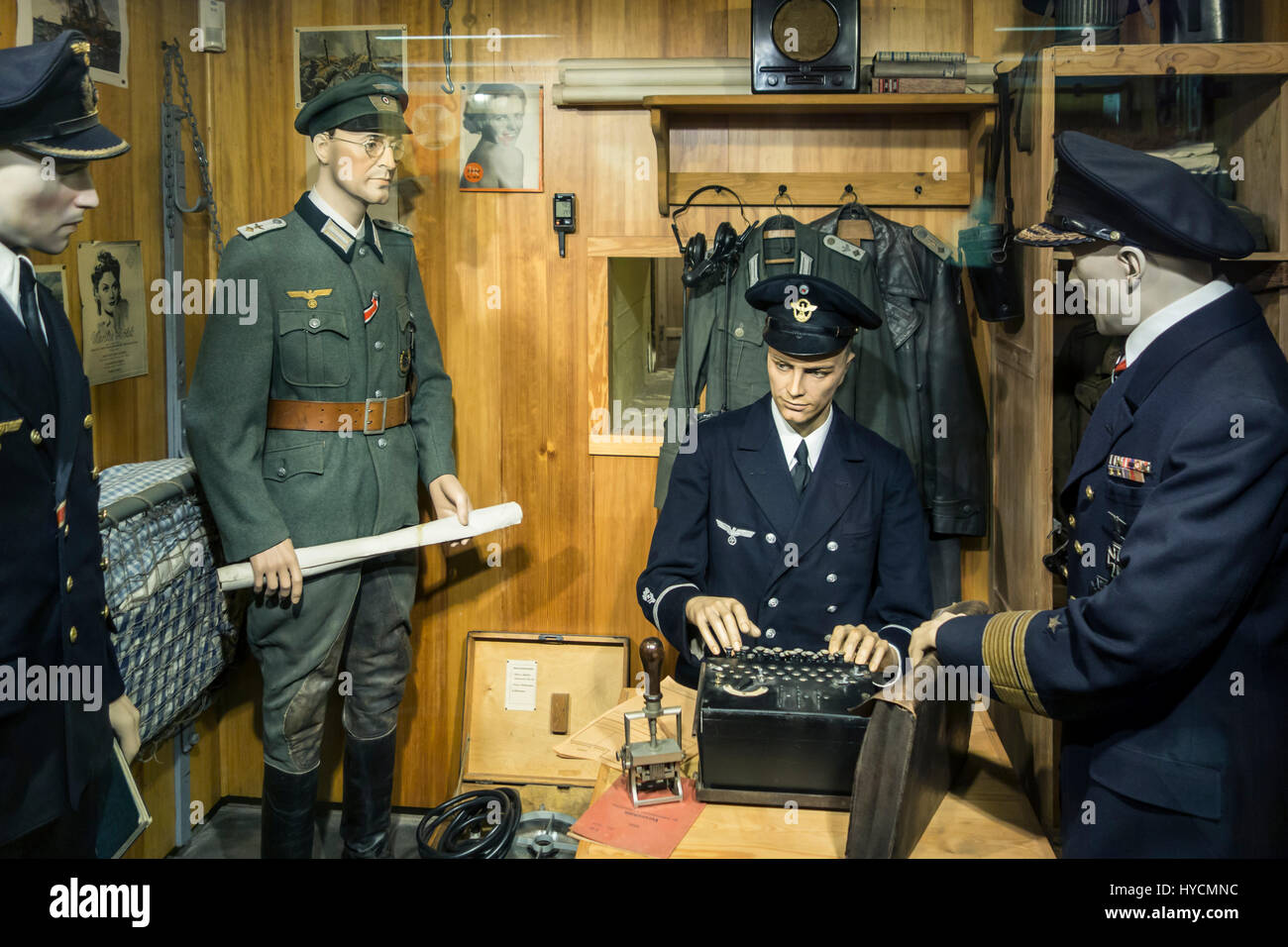 German WWII officer using 3-rotor Wehrmacht Enigma machine at Raversyde Atlantikwall / Atlantic Wall museum at Raversijde, Stock Photo