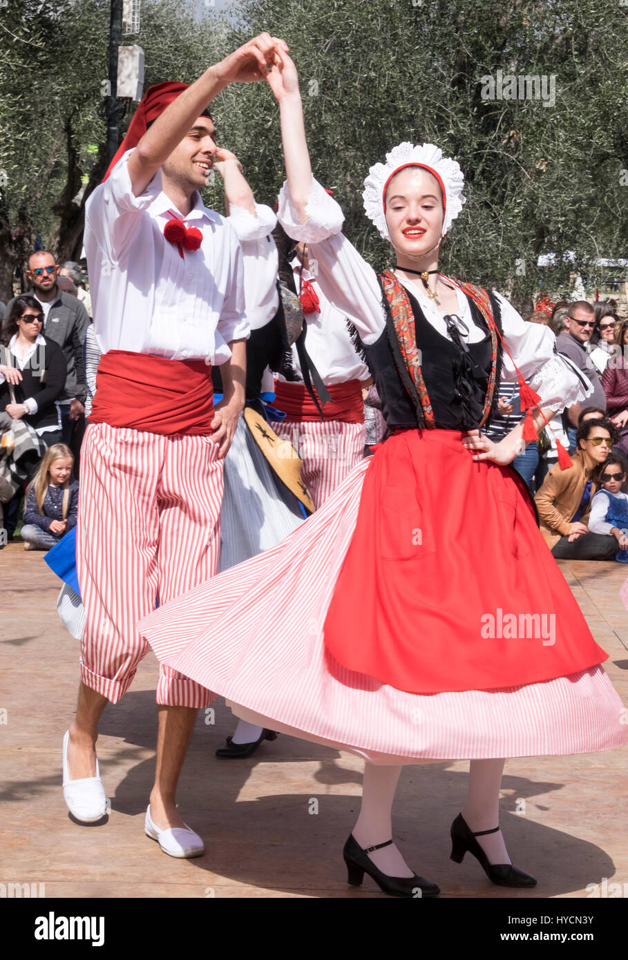 Folk dancers of Nice, France performing a traditional dance of the Alpes-Maritime region in authentic costumes of - Stock Image