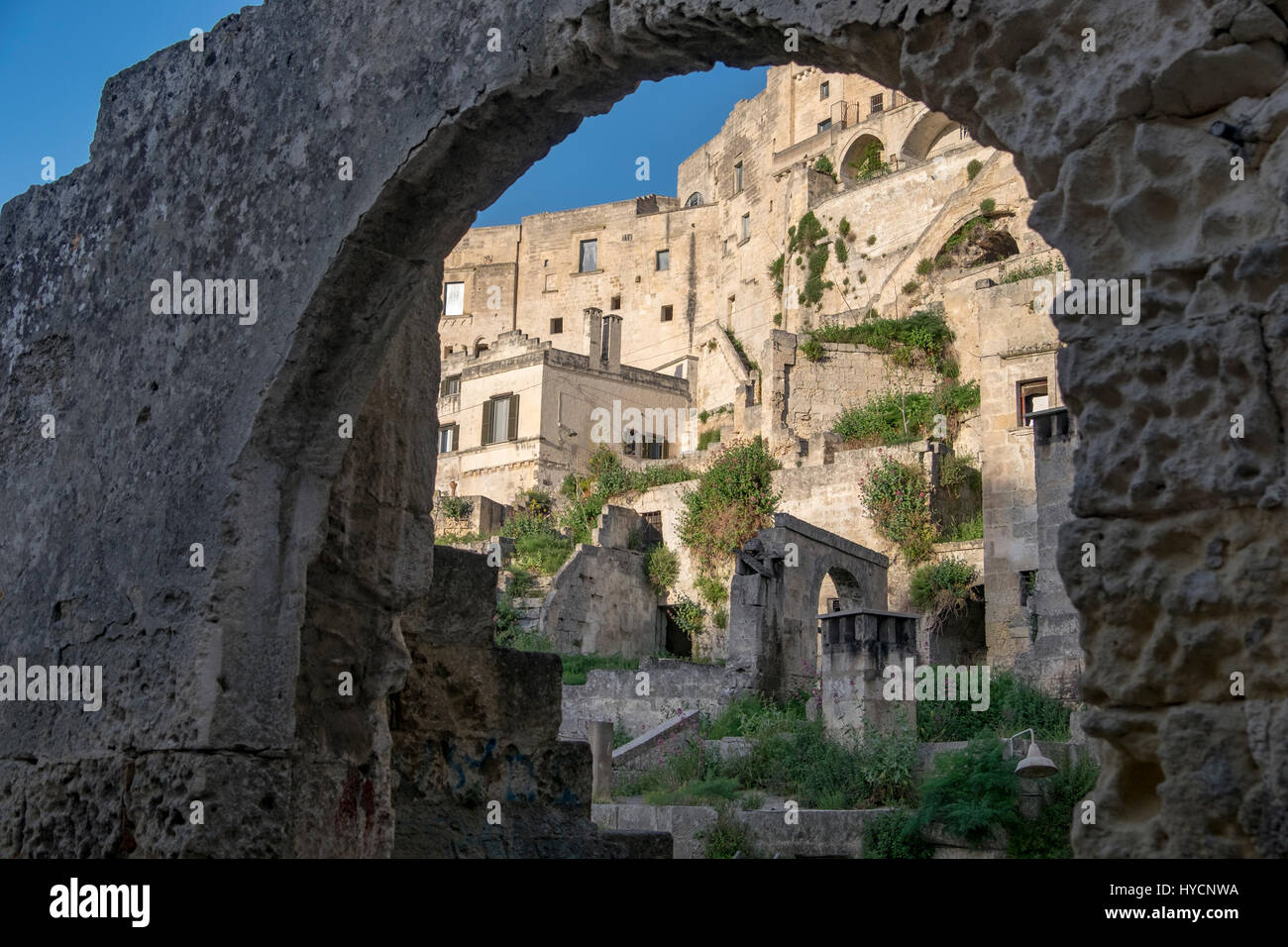 View of Matera, Italy, World Heritage Site and European Capital of Culture for 2019, as seen through a stone arch. - Stock Image